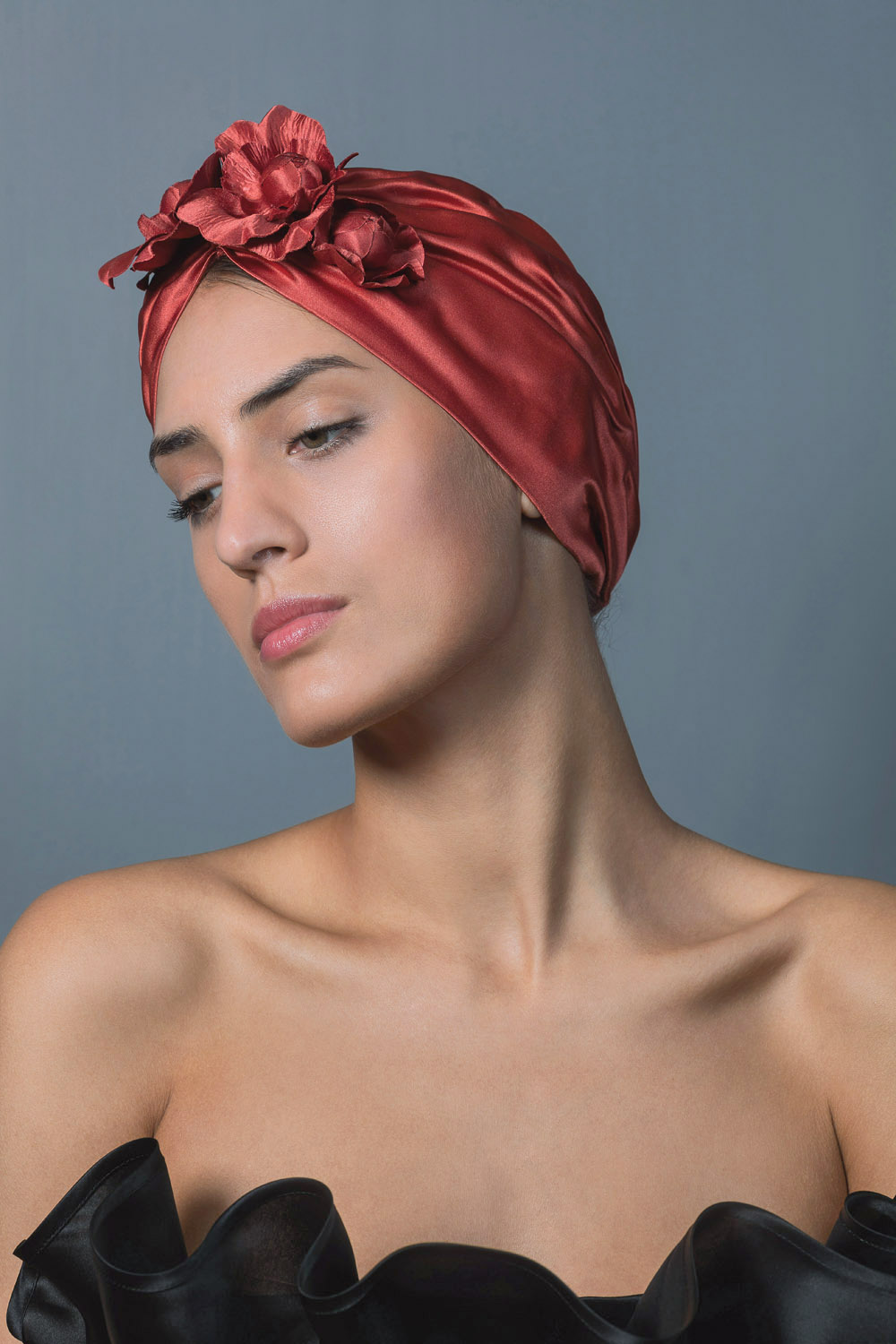 YELLOW RUCHED SATIN TURBAN DECORATED WITH CORAL SATIN FLOWERS